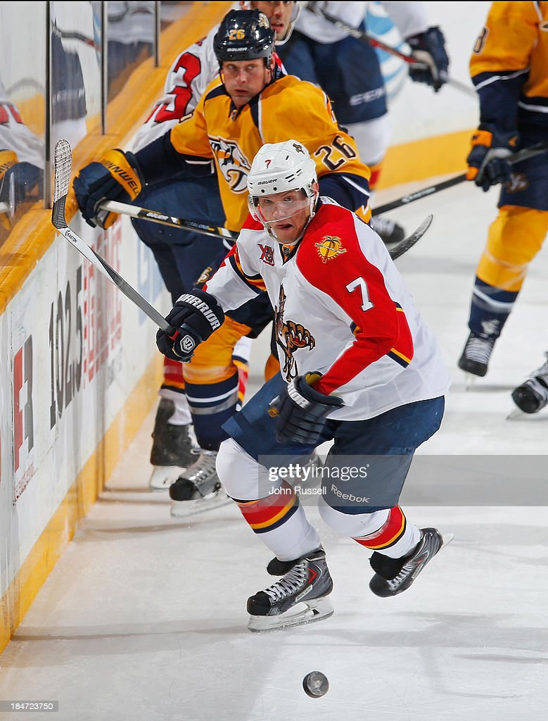 Dmitry Kulikov #7 of the Florida Panthers chases after the puck against the Nashville Predators at Bridgestone Arena on October 15, 2013 in Nashville, Tennessee.