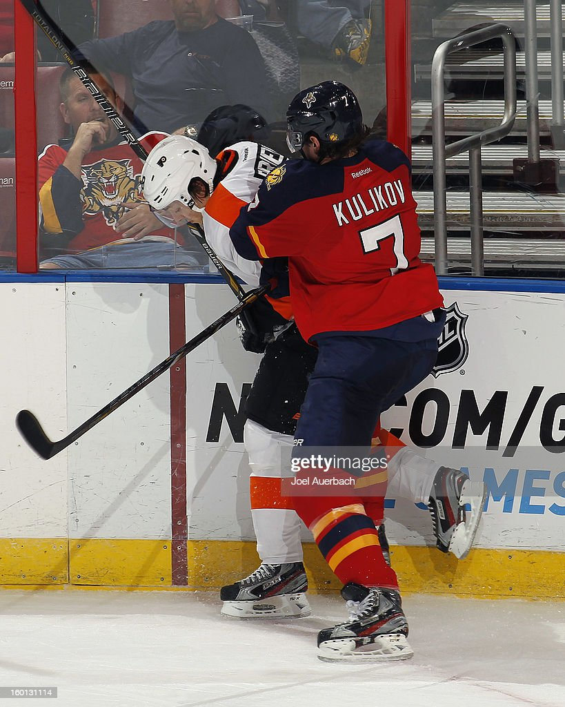 Dmitry Kulikov #7 of the Florida Panthers checks Danny Briere #48 of the Philadelphia Flyers at the BB&T Center on January 26, 2013 in Sunrise, Florida. The Flyers defeated the Panthers 7-1. Photo by Joel Auerbach/Getty Images)