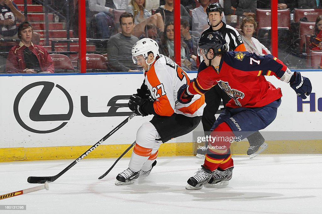 Dmitry Kulikov #7 of the Florida Panthers defends against <a gi-track='captionPersonalityLinkClicked' href=/galleries/search?phrase=Bruno+Gervais&family=editorial&specificpeople=215079 ng-click='$event.stopPropagation()'>Bruno Gervais</a> #27 of the Philadelphia Flyers at the BB&T Center on January 26, 2013 in Sunrise, Florida. The Flyers defeated the Panthers 7-1. Photo by Joel Auerbach/Getty Images)