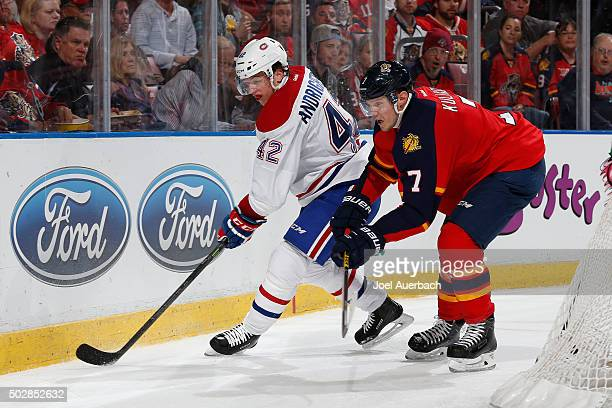 Dmitry Kulikov of the Florida Panthers defends against Sven Andrighetto of the Montreal Canadiens as he circles the net with the puck at the BBT...