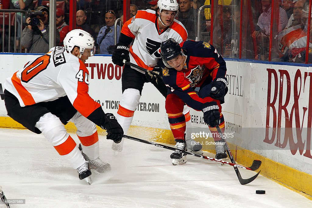 Dmitry Kulikov #7 of the Florida Panthers digs the puck out from the boards against Vincent Lecavalier #40 of the Philadelphia Flyers at the BB&T Center on April 8, 2014 in Sunrise, Florida.