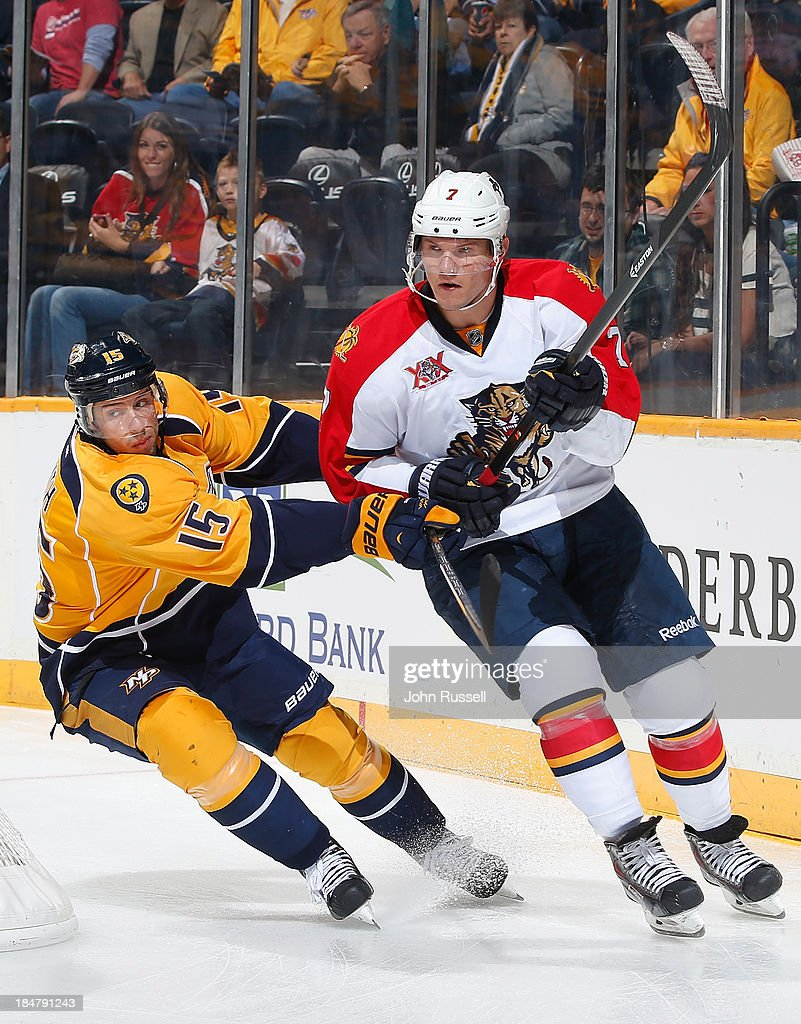 Dmitry Kulikov #7 of the Florida Panthers skates against Craig Smith #15 of the Nashville Predators at Bridgestone Arena on October 15, 2013 in Nashville, Tennessee.