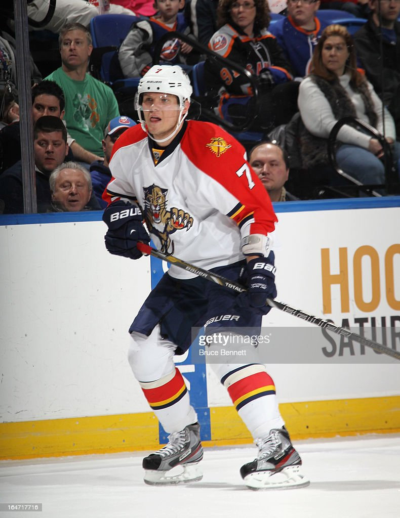 Dmitry Kulikov #7 of the Florida Panthers skates against the New York Islanders at the Nassau Veterans Memorial Coliseum on March 24, 2013 in Uniondale, New York.