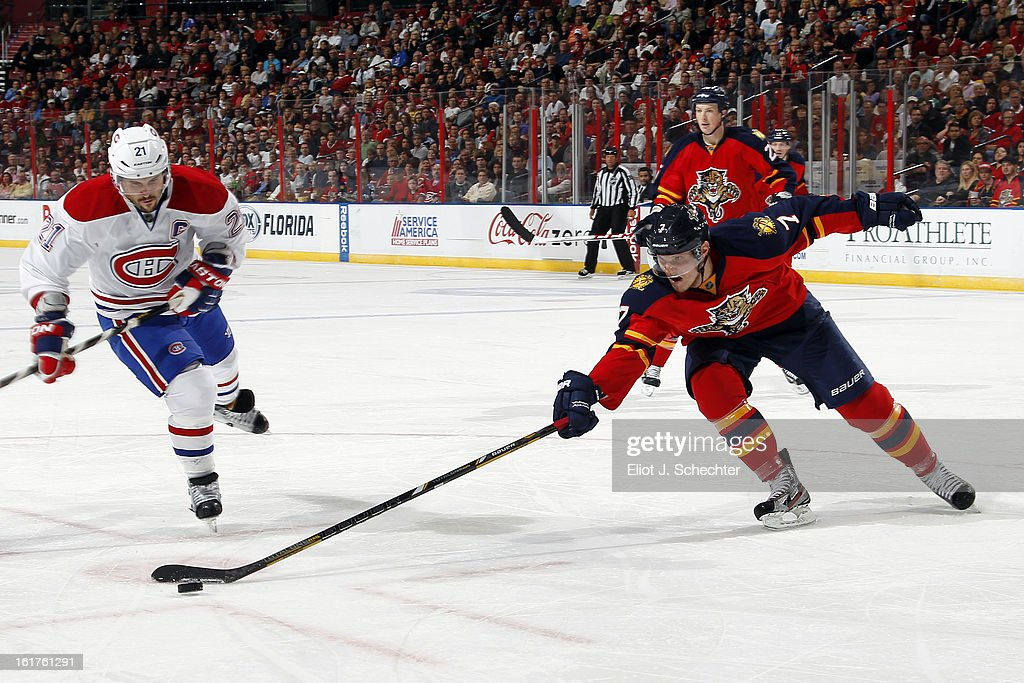 Dmitry Kulikov #7 of the Florida Panthers skates for possession against Brian Gionta #21 of the Montreal Canadiens at the BB&T Center on February 14, 2013 in Sunrise, Florida.