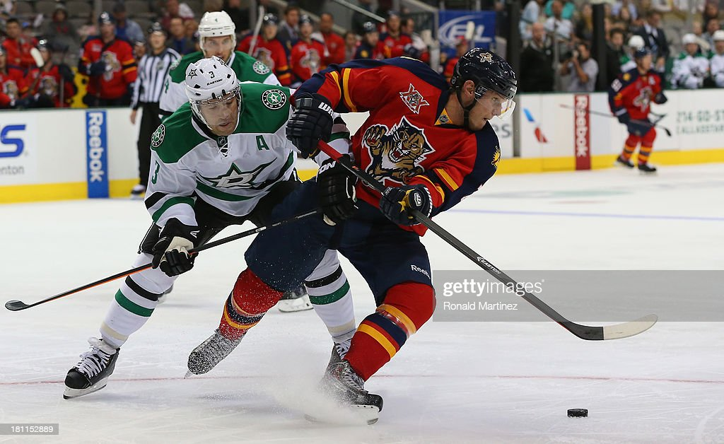 Dmitry Kulikov #7 of the Florida Panthers skates the puck past <a gi-track='captionPersonalityLinkClicked' href=/galleries/search?phrase=Stephane+Robidas&family=editorial&specificpeople=206166 ng-click='$event.stopPropagation()'>Stephane Robidas</a> #3 of the Dallas Stars during a preseason game at American Airlines Center on September 18, 2013 in Dallas, Texas.