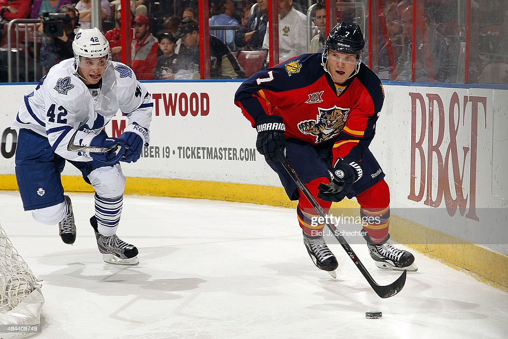 Dmitry Kulikov #7 of the Florida Panthers skates with the puck against <a gi-track='captionPersonalityLinkClicked' href=/galleries/search?phrase=Tyler+Bozak&family=editorial&specificpeople=6183313 ng-click='$event.stopPropagation()'>Tyler Bozak</a> #42 of the Toronto Maple Leafs at the BB&T Center on April 10, 2014 in Sunrise, Florida.