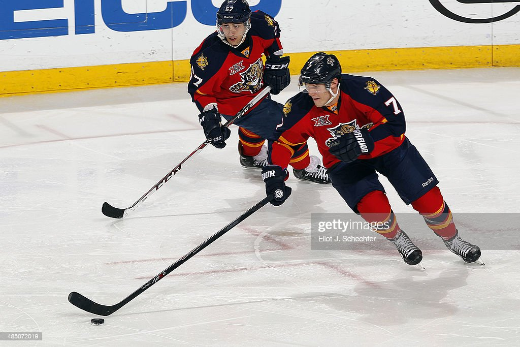 Dmitry Kulikov #7 of the Florida Panthers skates with the puck with teammate Vincent Trocheck #67 against the Columbus Blue Jackets at the BB&T Center on April 12, 2014 in Sunrise, Florida.