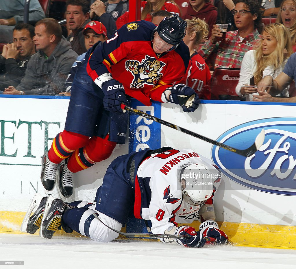 Dmitry Kulikov #7 of the Florida Panthers tangles with Alex Ovechkin #8 of the Washington Capitals at the BB&T Center on April 6, 2013 in Sunrise, Florida.