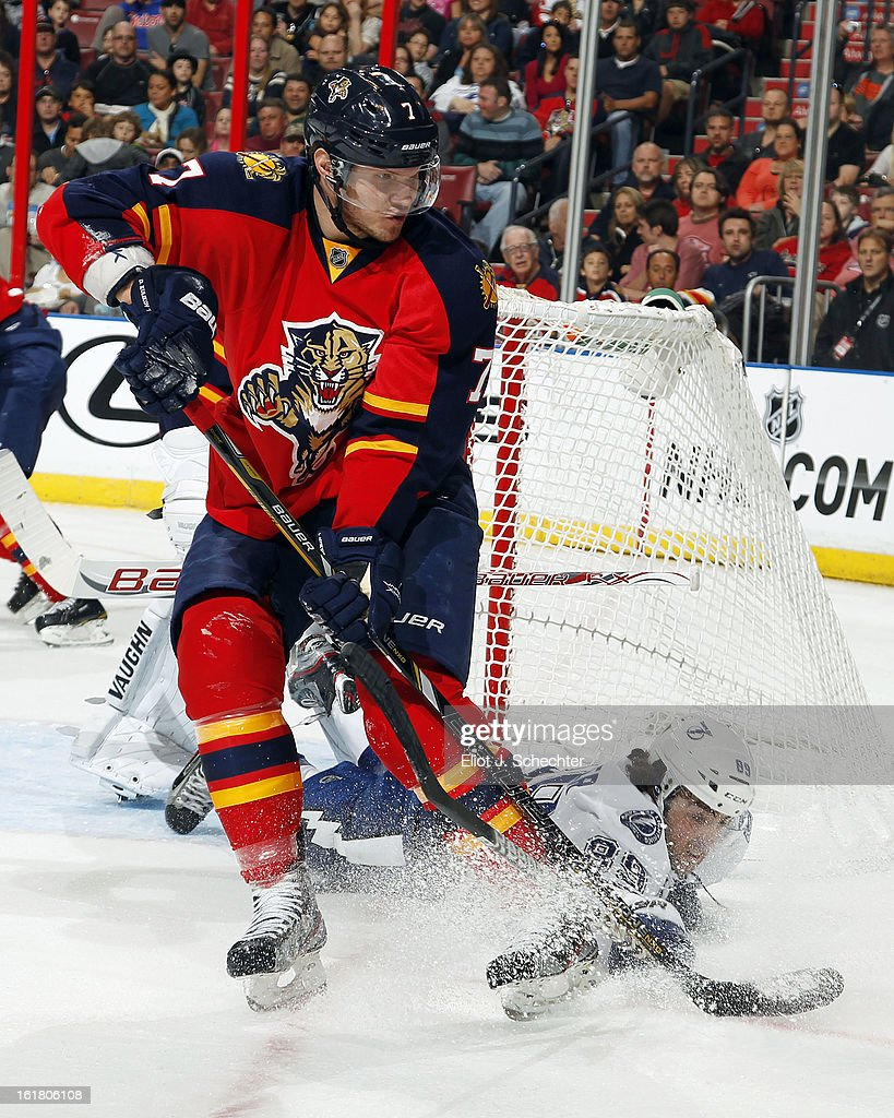 Dmitry Kulikov #7 of the Florida Panthers tangles with Cory Conacher #89 of the Tampa Bay Lightning at the BB&T Center on February 16, 2013 in Sunrise, Florida.