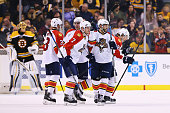 Dmitry Kulikov of the Florida Panthers Vincent Trocheck Steven Kampfer and Reilly Smith congratulate Jussi Jokinen after he scored against the Boston...