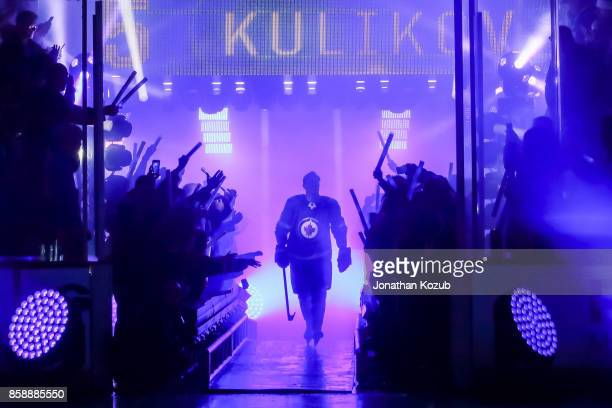 Dmitry Kulikov of the Winnipeg Jets heads to the ice for the player introductions prior to puck drop against the Toronto Maple Leafs for the home...