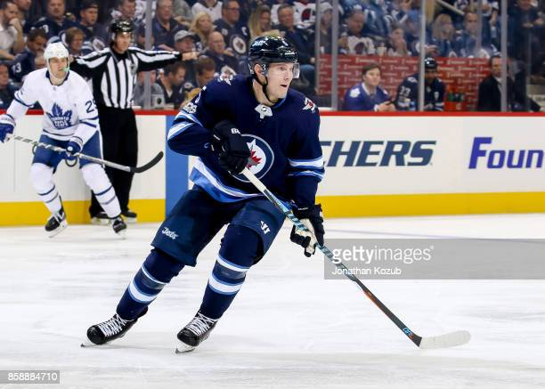Dmitry Kulikov of the Winnipeg Jets keeps an eye on the play during second period action against the Toronto Maple Leafs at the Bell MTS Place on...