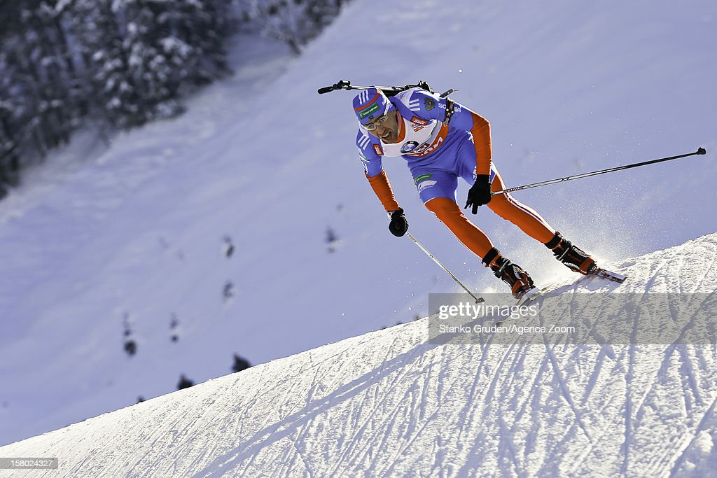 Dmitry Malyshko of Russia take 3rd place during the IBU Biathlon World Cup Men's Relay on December 9, 2012 in Hochfilzen, Austria.