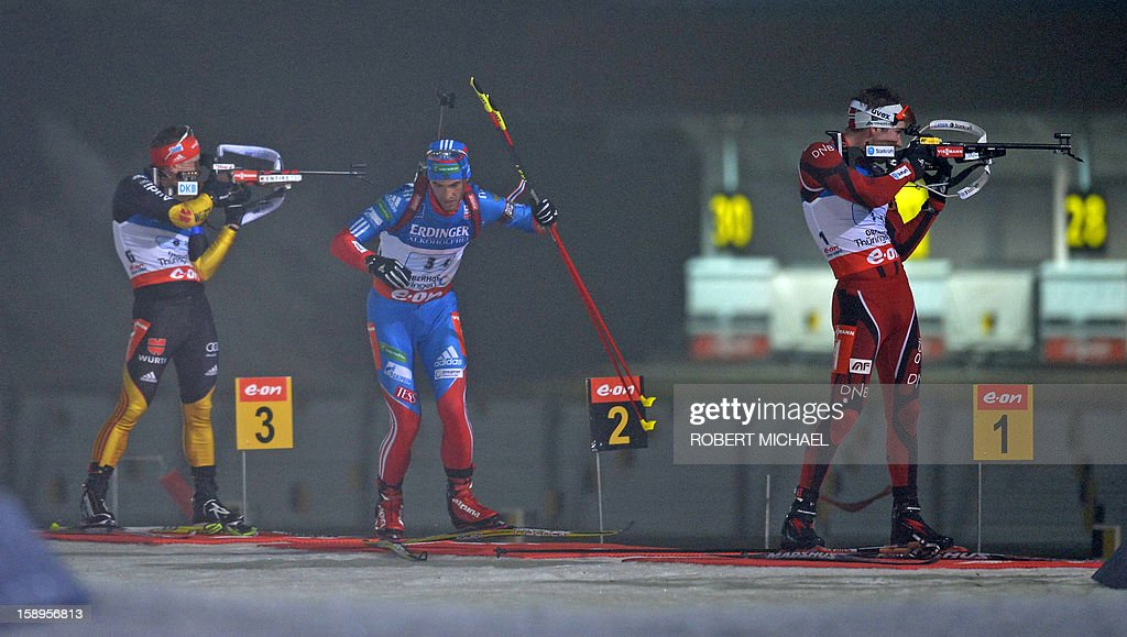 Dmitry Malyshko of winner team Russia (C) leaves the shooting range before Hegle Emil Svendsen (R) of second placed team Norway and Florian Graf (L) of third placed team Germany in the Men's IBU Biathlon World Cup 4 x 7,5 km relay event in Oberhof, eastern Germany, on January 4, 2013. AFP PHOTO / ROBERT MICHAEL