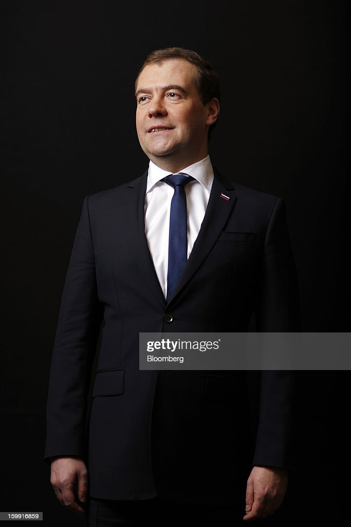 Dmitry Medvedev, Russia's prime minister, poses for a photograph following a Bloomberg Television interview on the opening day of the World Economic Forum (WEF) in Davos, Switzerland, on Wednesday, Jan. 23, 2013. World leaders, Influential executives, bankers and policy makers attend the 43rd annual meeting of the World Economic Forum in Davos, the five day event runs from Jan. 23-27. Photographer: Simon Dawson/Bloomberg via Getty Images