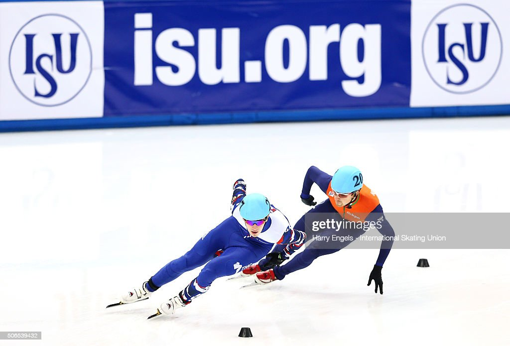 Dmitry Migunov of Russia (L) leads Freek van der Wart of the Netherlands during the Men's 1000m Quarterfinals on day three of the ISU European Short Track Speed Skating Championships at the Iceberg Skating Palace on January 24, 2016 in Sochi, Russia.
