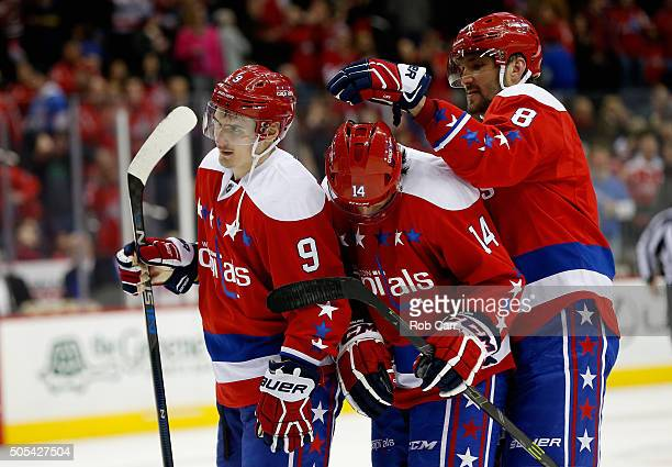 Dmitry Orlov looks on as Alex Ovechkin of the Washington Capitals jokes around with teammate Justin Williams following the Wizards 52 win over the...