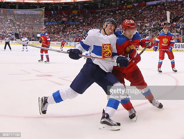 Dmitry Orlov of Team Russia bumps Patrik Laine of Team Finland during the second period during the World Cup of Hockey tournament at the Air Canada...