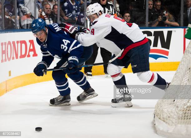 Dmitry Orlov of the Washington Capitals and Auston Matthews of the Toronto Maple Leafs battle for the puck during the first period in Game Six of the...