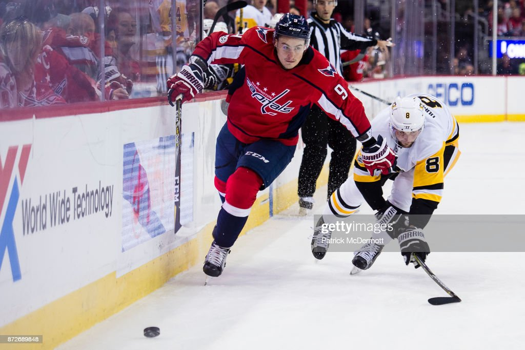 Dmitry Orlov #9 of the Washington Capitals and Brian Dumoulin #8 of the Pittsburgh Penguins battle for the puck in the third period at Capital One Arena on November 10, 2017 in Washington, DC.