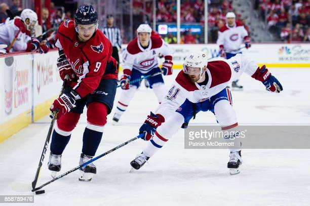 Dmitry Orlov of the Washington Capitals and Paul Byron of the Montreal Canadiens battle for the puck in the second period at Capital One Arena on...