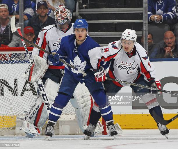 Dmitry Orlov of the Washington Capitals battles against William Nylander of the Toronto Maple Leafs in Game Four of the Eastern Conference...