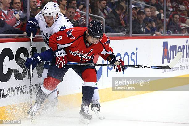 Dmitry Orlov of the Washington Capitals battles Bo Horvat of the Vancouver Canucks for the puck in the first period at Verizon Center on January 14...