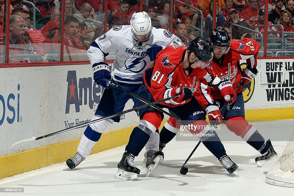Dmitry Orlov #81 of the Washington Capitals battles for the puck against Alex Killorn #17 of the Tampa Bay Lightning in the third period during an NHL game at Verizon Center on April 13, 2014 in Washington, DC.