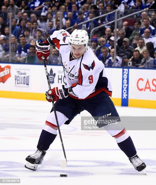 Dmitry Orlov of the Washington Capitals carries the puck against the Toronto Maple Leafs during the second period in Game Four of the Eastern...