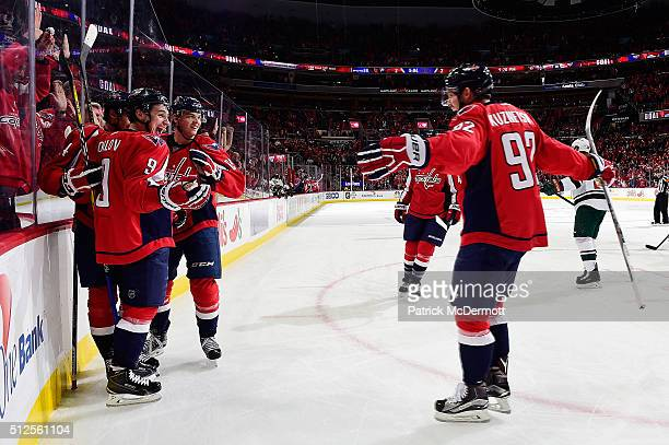 Dmitry Orlov of the Washington Capitals celebrates his third period goal with his teammates during their game against the Minnesota Wild at Verizon...