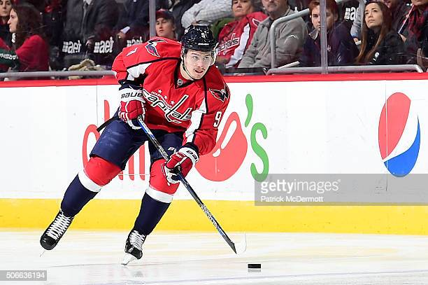Dmitry Orlov of the Washington Capitals controls the puck in the third period during an NHL game against the Tampa Bay Lightning at Verizon Center on...