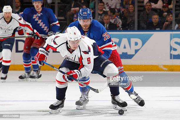 Dmitry Orlov of the Washington Capitals skates with the puck against Viktor Stalberg of the New York Rangers at Madison Square Garden on November 3...