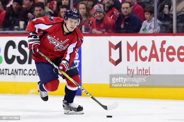 Dmitry Orlov of the Washington Capitals skates with the puck against the Minnesota Wild in the first period during an NHL game at Verizon Center on...