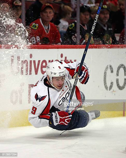 Dmitry Orlov of the Washington Capitals slips and hits the ice chasing the puck against the Chicago Blackhawks at the United Center on February 28...