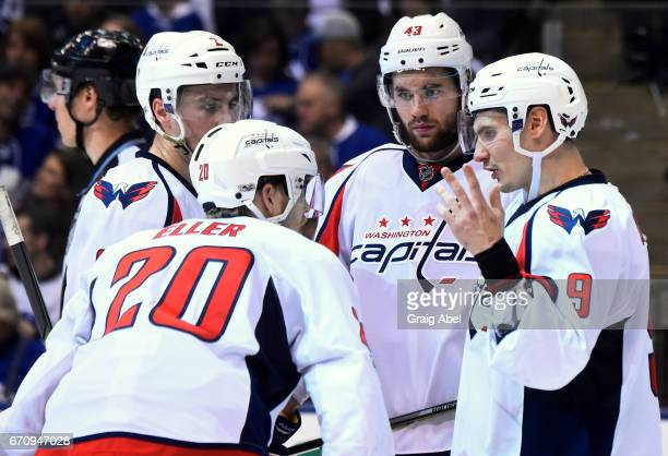 Dmitry Orlov of the Washington Capitals talks with teammates Tom Wilson Lars Eller and Matt Niskanen during the third period of play against the...