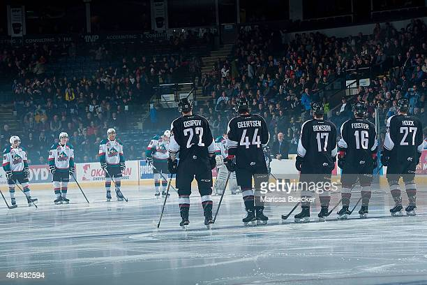 Dmitry Osipov Mason Geertsen Tyler Benson Thomas Foster and Jackson Houck of Vancouver Giants line up against the Kelowna Rockets on January 7 2015...