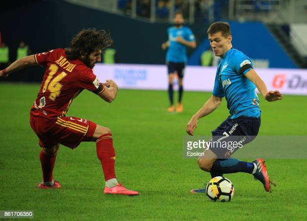Dmitry Poloz of FC Zenit St Petersburg vies for the ball with Anri Khagush of FC Arsenal Tula during the during the Russian Premier League match...