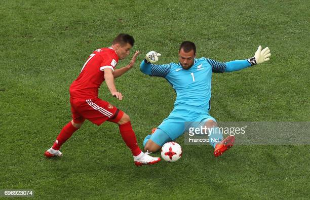 Dmitry Poloz of Russia is challenged by Stefan Marinovic of New Zealand in the penalty area during the FIFA Confederations Cup Russia 2017 Group A...