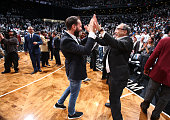 Dmitry Razumov high fives Bruce Ratner after the Brooklyn Nets defeats the Atlanta Hawks in Game Four of the Eastern Conference Quarterfinals during...