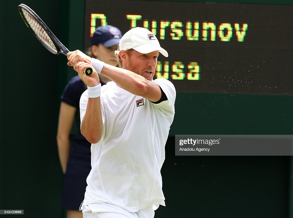 Dmitry Tursunov of Russia (C) in action against Joao Sousa (not seen) of Portugal during the Men's Singles match on day two of the 2016 Wimbledon Championships at the All England Lawn and Croquet Club in London, United Kingdom on June 28 2016.