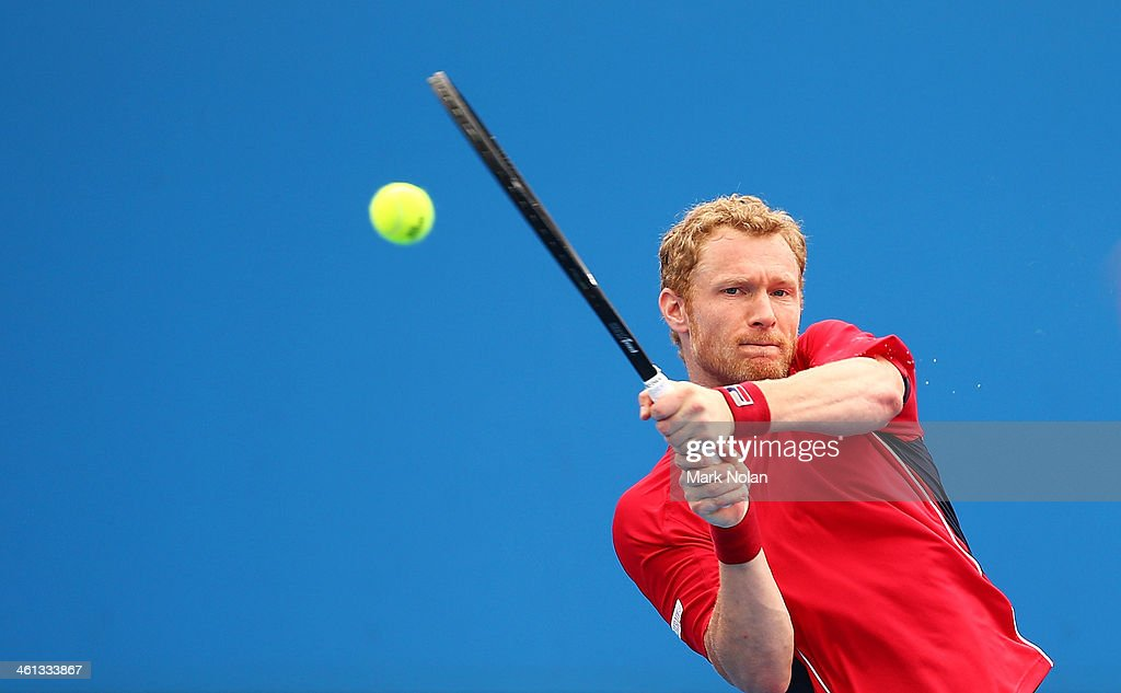 Dmitry Tursunov of Russia plays a backhand in his match against Lukas Rosol of the Czech Republic during day four of the 2014 Sydney International at Sydney Olympic Park Tennis Centre on January 8, 2014 in Sydney, Australia.