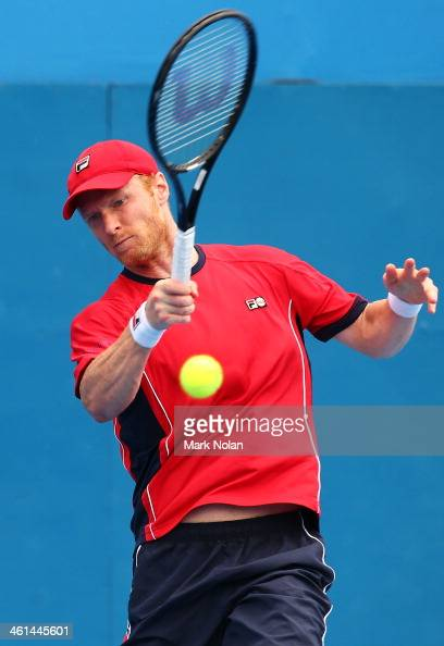 Dmitry Tursunov of Russia plays a forehand in his match against Denis Istomin of Uzbekistan during day five of the 2014 Sydney International at...