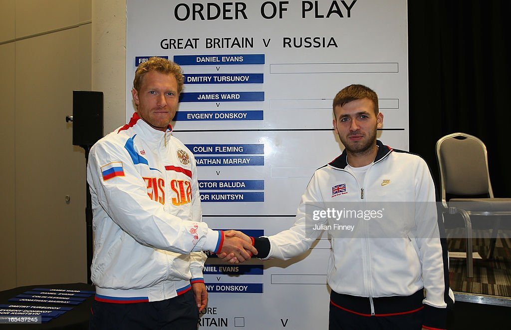 Dmitry Tursunov of Russia shakes hands with Daniel Evans of Great Britain during previews for the Davis Cup match between Great Britain and Russia at the Ricoh Arena on April 4, 2013 in Coventry, England.