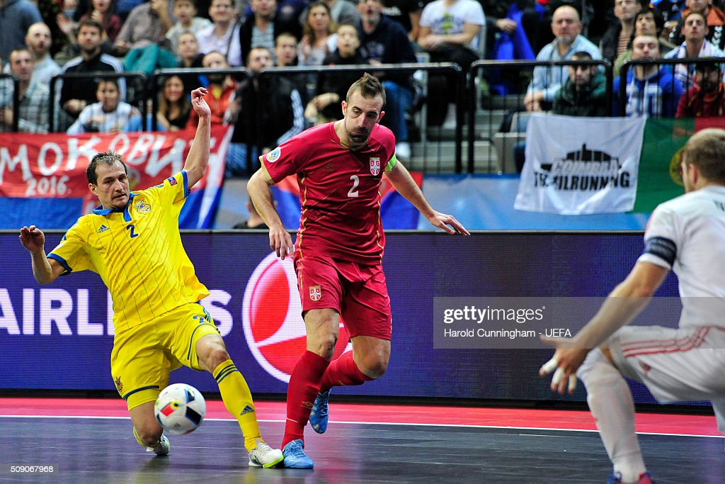 Dmytro Sorokin of Ukraine and Marko Peric of Serbia in action during the UEFA Futsal EURO 2016 quarter final match between Serbia and Ukraine at Arena Belgrade on February 8, 2016 in Belgrade, Serbia.
