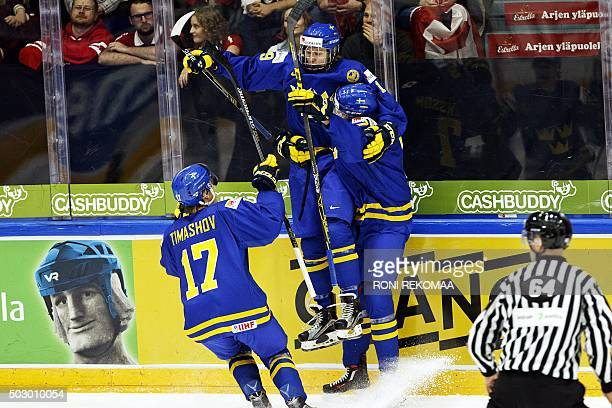 Dmytro Timashov goal scorer Alexander Nylander and Marcus Pettersson of team Sweden celebrate opening goal during the 2016 IIHF World Junior U20 Ice...