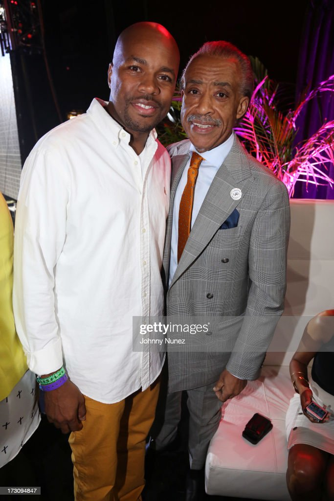 D-Nice and Al Sharpton attend the 2013 Essence Festival at the Mercedes-Benz Superdome on July 6, 2013 in New Orleans, Louisiana.