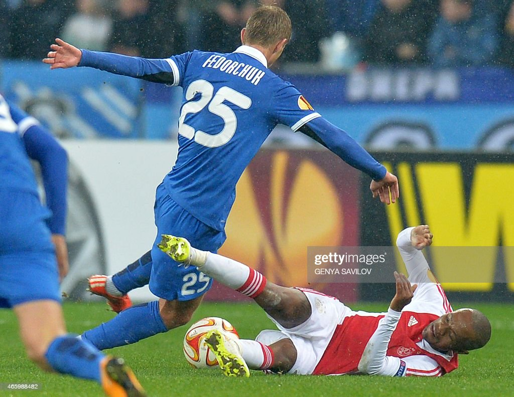 FC Dnipro Dnipropetrovsk Valeriy Fedorchuk (L) of FC Dnipro Dnipropetrovsk fight for a ball against Ajax's <a gi-track='captionPersonalityLinkClicked' href=/galleries/search?phrase=Thulani+Serero&family=editorial&specificpeople=6234374 ng-click='$event.stopPropagation()'>Thulani Serero</a>(L) during the Europa League Round of 16 match between Dnipropetrovsk and Ajax Amsterdam in Kiev on March 12, 2015.