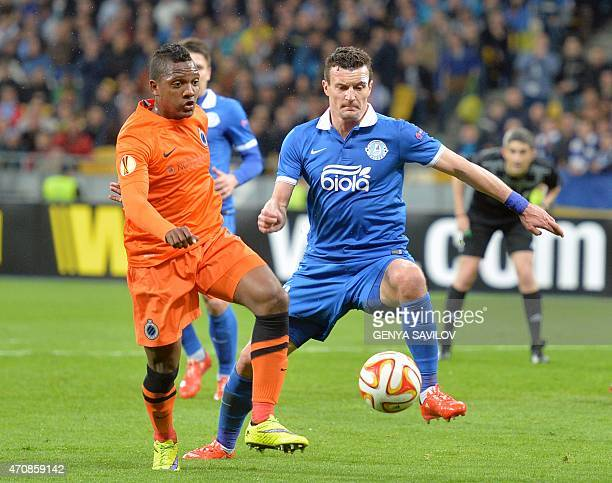 FC Dnipro's Artem Fedetskiy vies with Brugge's Jose Izquierdo during the UEFA Europa League second leg quarterfinal football match between FC Dnipro...