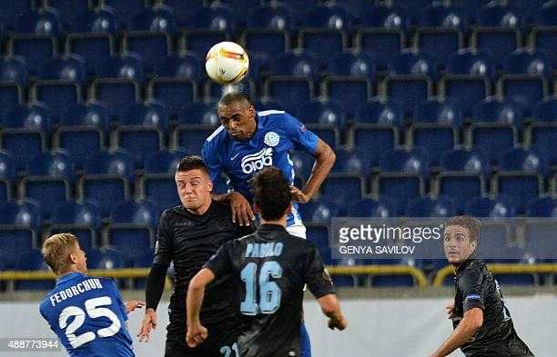 FC Dnipro's Douglas vies with Lazio's Sergej MilinkovicSavic during the UEFA Europa League Group G football match between Dnipro Dnipropetrovsk and...