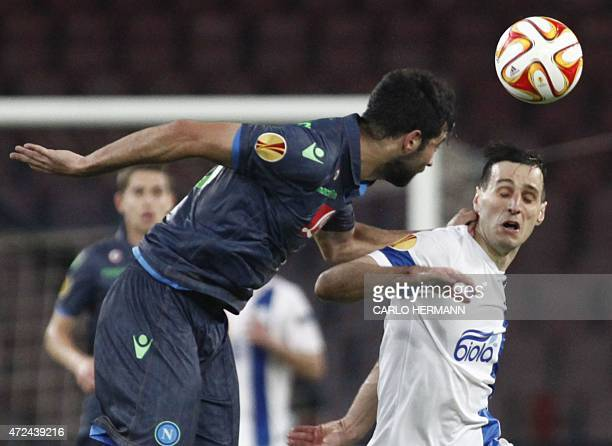 Dnipro's forward from Croatia Nikola Kalinic fights for the ball with Napoli's defender from Spain Raul Albiol during the UEFA Europa League semi...